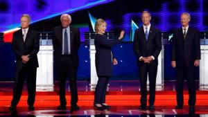 U.S. presidential candidate and former U.S. Secretary of State Hillary Clinton waves as she stands with fellow candidates (L-R) former U.S. Senator Jim Webb, U.S. Senator Bernie Sanders, former Maryland Governor Martin O'Malley and former Governor of Rhode Island Lincoln Chafee at the first official Democratic candidates debate of the 2016 presidential campaign in Las Vegas, Nevada October 13, 2015. REUTERS/Lucy Nicholson