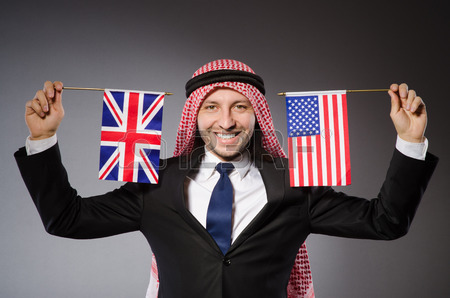 28920772-arab-man-with-united-kingdom-flag