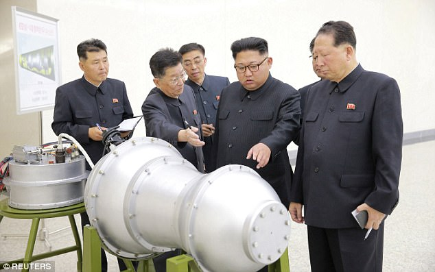 North Korea's leader Kim Jong-un with atomic weapon