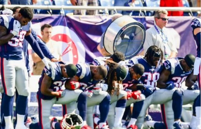 Reaction-NFL-players-kneel-lock-arms-National-Anthem-730x470